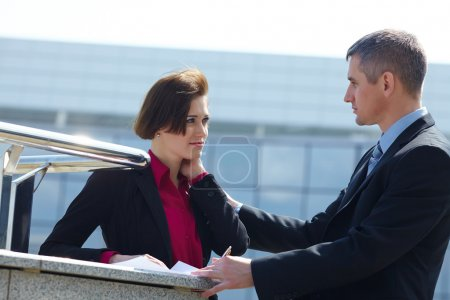 Photo for Business man and woman having conversation outdoors - Royalty Free Image