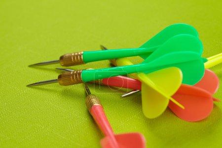 dart arrows on green