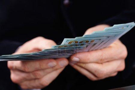 Businessman holding banknotes