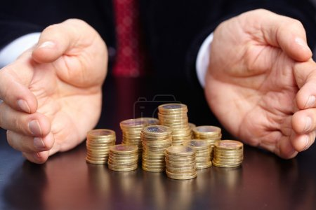 Businessman with stacks of coins