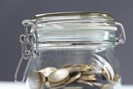 closed jar with coins