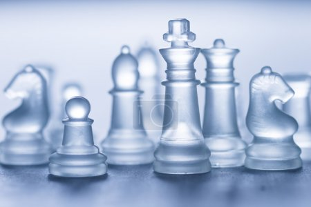 glass chess on grey