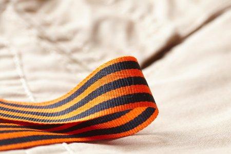 Ribbon with orange and black stripes