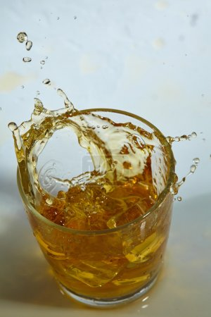 Whiskey with ice cubes in glass