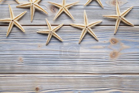 Starfishes on wooden table