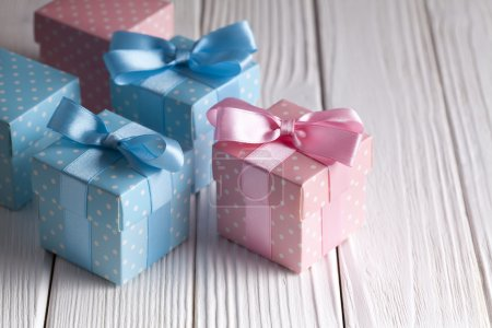 Colorful gift boxes on wooden table