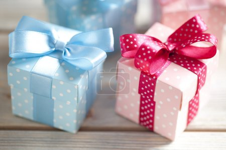 Colored gift boxes on wooden planks