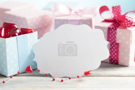 Blank white label and colored gift boxes