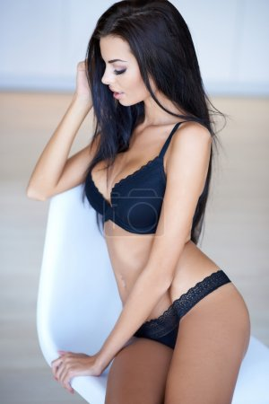 Beautiful graceful young woman in lingerie