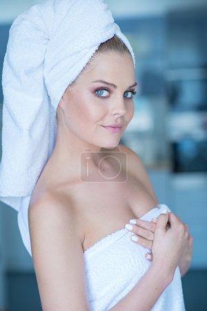 Young Woman Wearing White Bath Towel