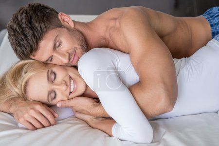 Smiling Middle Age Lovers Lying in Bed So Sweet