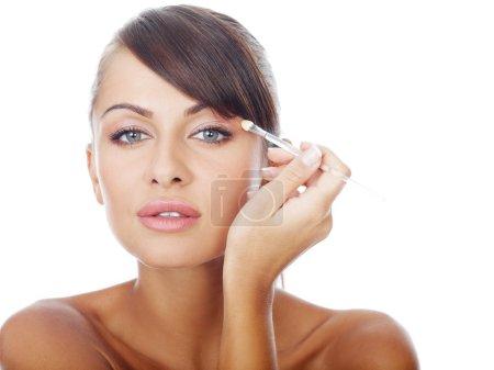 Woman Applying Eye Shadow Make-up