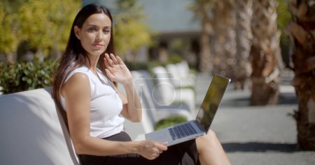 businesswoman working on park bench