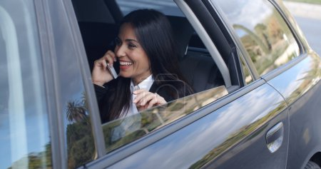 businesswoman talking on phone in limousine