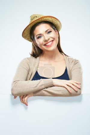 girl posing with straw hat