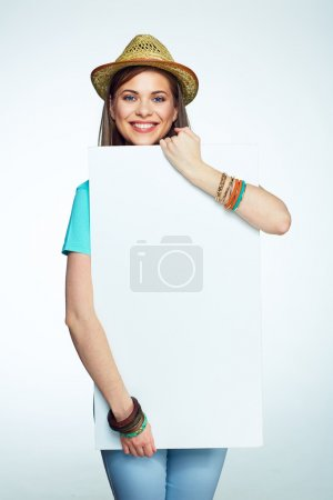 Smiling woman holding sign board