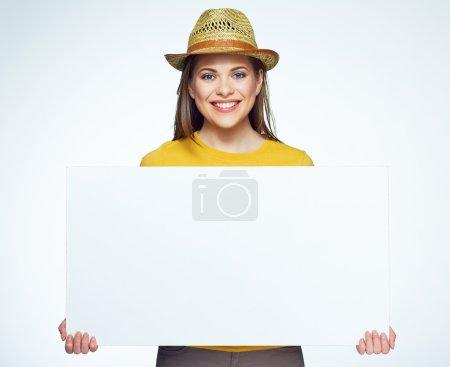 Girl holding  white sign board.