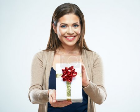 Photo for Portrait of smiling woman holding white gift box with red ribbon - Royalty Free Image
