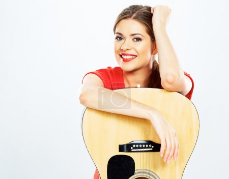 Smiling woman with acoustic guitar