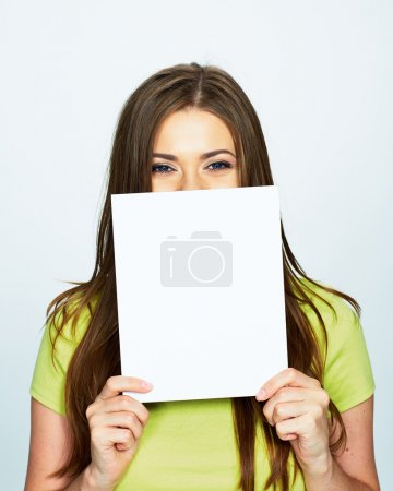 Photo for Young woman holds white banner hiding face isolated on white background - Royalty Free Image