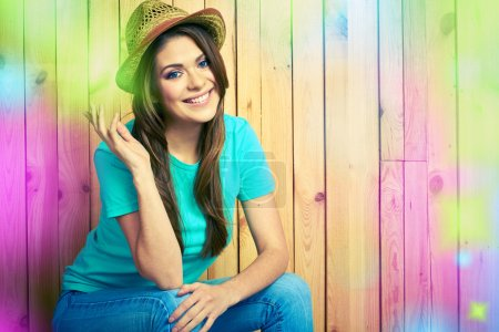 Photo for American country style portrait of young woman in hat posing on wooden background - Royalty Free Image