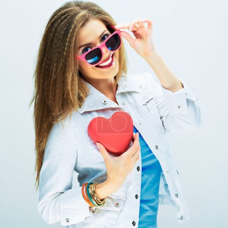 Woman holds red heart