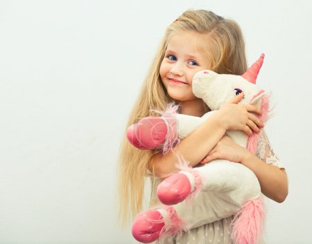girl with white unicorn toy