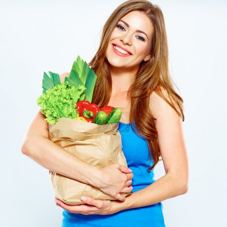 Woman with vegan food in bag