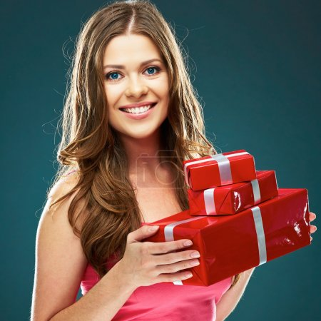 Photo for Smiling happy woman holding red gift boxes on dark background - Royalty Free Image