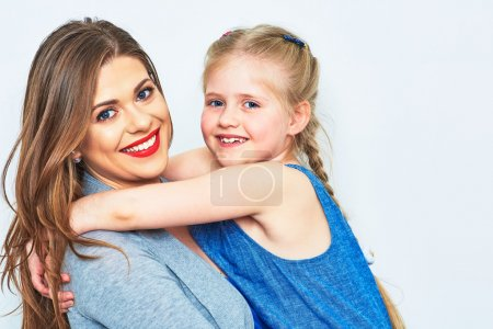 Photo for Mother and daughter embracing, Smiling and happy woman with little girl - Royalty Free Image