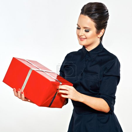 Smiling woman holds red gift box