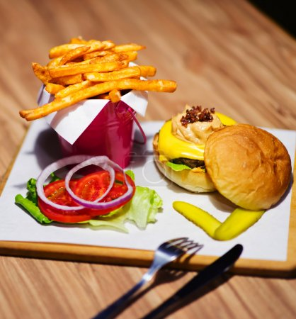Photo for A delicious meal set of hamburger, chips and drink - Royalty Free Image