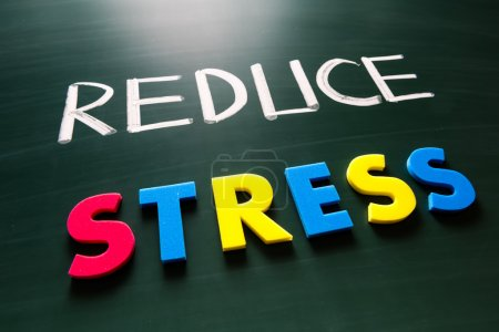 Photo for Reduce stress concept, colorful words on blackboard - Royalty Free Image