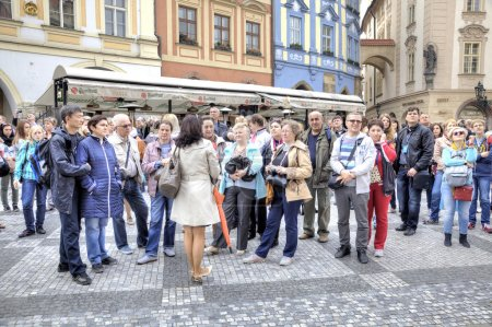 Prague. The guide speaks with tourists