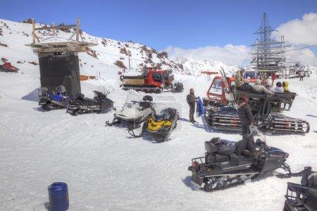 Snowmobiles on the slope of mountain Elbrus