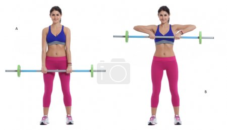 Foto de Step by step instructions: Stand up and hold the barbell with your hands in front of your thighs, hands at a medium-grip position, palms facing backwards. (A) Raise the barbell until it reaches the top of your chest and lower it back down slowly. (B) - Imagen libre de derechos