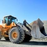 Big yellow mining truck in quarry...