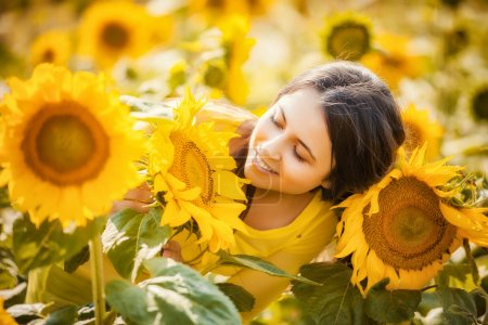 Photo for Rural girl on sunflower field - Royalty Free Image