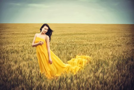 Photo for Young girl on wheat field - Royalty Free Image