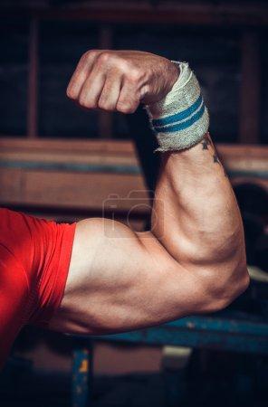 Male bodybuilder flexing muscles