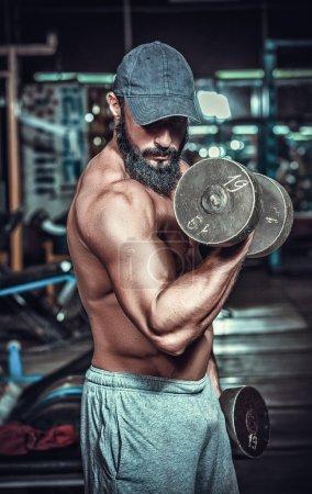 Muscular bodybuilder doing exercises