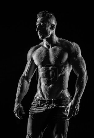 Photo for Very muscular handsome athletic man on black background, naked torso - Royalty Free Image