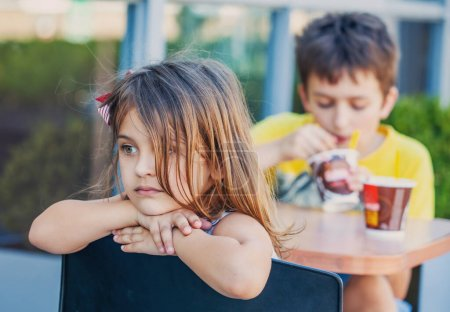 Photo for Portait little girl at ice cream cafe - Royalty Free Image