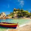Small boat for excursion in front of the island Is...