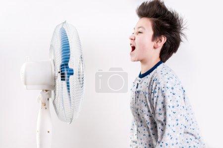 Photo for Boy near the ventilator - Royalty Free Image
