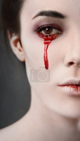 Photo for Portrait of a female vampire over black background - Royalty Free Image