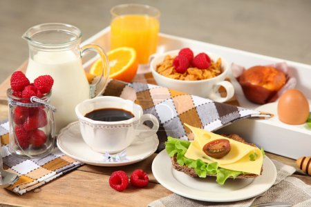 Photo for Healthy continental breakfast on wooden table - Royalty Free Image