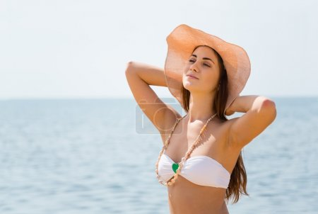 Portrait of beautiful girl resting on the beach