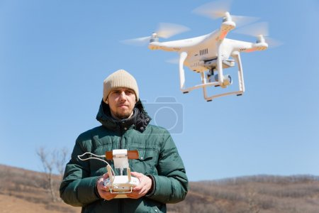 Photo for Man controls the flying drones spring - Royalty Free Image