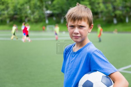 Boy soccer player in training
